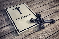 Exorcism book on wooden floor Royalty Free Stock Photo