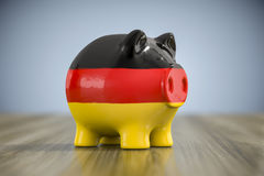 Fat piggy bank in german colors Stock Images