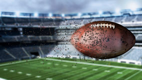 3d illustration of flying american football leaving a trail of dust and smoke. Spinning dirty american football Royalty Free Stock Photos