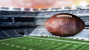 3d illustration of flying american football leaving a trail of smoke. Spinning dirty american footbal. Flying football leaving a trail of dust and smoke Stock Images