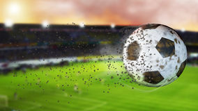 3d illustration of flying football leaving a trail of dust and smoke. Spinning dirty soccer ball, selerctive focus. Royalty Free Stock Photo