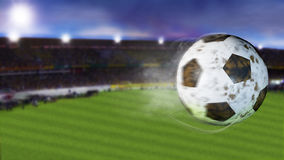 3d illustration of flying football leaving a trail of smoke. Spinning dirty soccer ball, selerctive focus. Stock Photo