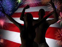 ( 3D illustration )In front of the American flag. Two happy young people are jumping for joy in front of the American flag Stock Images