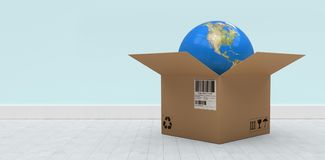 Composite 3d image of illustration of globe in cardboard box. 3D illustration of globe in cardboard box against blue wall by hardwood floor Royalty Free Stock Photo