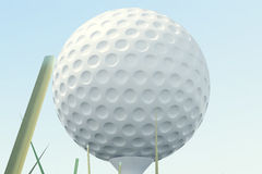 3D illustration Golf ball and ball in grass, close up view on tee ready to be shot. Golf ball on sky background. Royalty Free Stock Photography