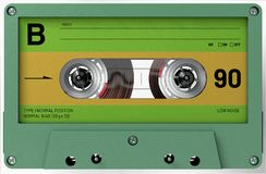 Green and yellow audio cassette with sticker and label royalty free stock photos