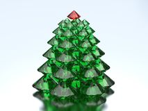 3D illustration green diamond christmas tree with a red star. On a blue background Stock Photography