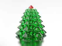 3D illustration group of green diamond christmas tree with a red. Star on a blue white background Royalty Free Stock Images