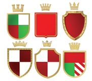 3D illustration of heraldic shields and golden crowns. Isolate. 3D illustration, 3d rendering, of heraldic shields and golden crowns. Isolated. 3d modeling Royalty Free Stock Images