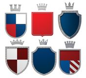 3D illustration of heraldic shields and silver crowns. 3D illustration, 3d rendering, of heraldic shields and silver crowns. Isolated. 3d modeling Stock Photos