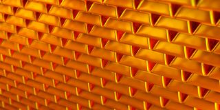 Stacked golden reflective and shiny gold bars or gold bullion royalty free stock images