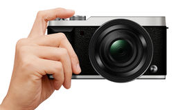 3D illustration interchangeable lens Mirrorless camera in hand Royalty Free Stock Photography
