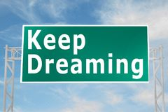 Keep Dreaming concept. 3D illustration of Keep Dreaming script on road sign Stock Photography