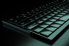 3d illustration of a keyboard. On a dark background Royalty Free Stock Photo
