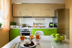 3D illustration of kitchen with beige and green facades Stock Photo