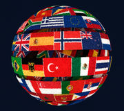 3D illustration of Knit National flags twisted as spiral globe. On dark Stock Photo