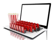 3d Laptop with blank screen and rows of cinema seats. 3d illustration. Laptop with blank screen and rows of cinema seats. Home cinema concept Royalty Free Stock Images