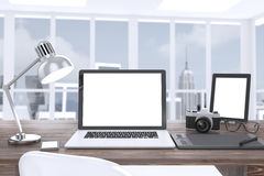 3D illustration laptop camera tablet on table in Royalty Free Stock Image