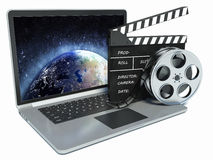 3d illustration of laptop and cinema clap and film reel. Royalty Free Stock Photography