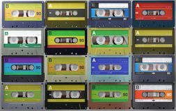 Lots of retro and vintage audio cassettes or audio tapes in different colored labels stock photo