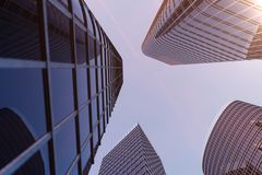 3D illustration Low angle view of skyscrapers. Skyscrapers at sunset looking up perspective. Bottom view of skyscrapers. In business district in evening light royalty free illustration