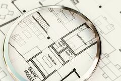 Magnifier on an architectural plan. 3d illustration of a magnifier on an architectural plan Royalty Free Stock Photo