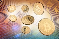 3d illustration of many bitcoin golden coin. Concept 3d illustration with many cryptocurrency golden coins with bitcoin logo in the background and fragments of Stock Photo
