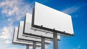 3D illustration of many blank white billboards against blue sky.  Royalty Free Stock Photos
