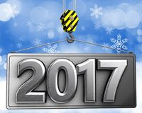 3d crane hook with metal 2017 sign. 3d illustration of metal 2017 sign with crane hook over snow background Stock Photo