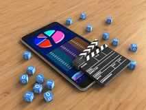 3d cinema clap. 3d illustration of mobile phone over wooden background with binary cubes and cinema clap Stock Photography