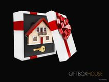 3d illustration of Model of a house in gift box with red ribbon, isolated black.  Royalty Free Stock Images
