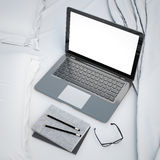 3D illustration of modern laptop on the bed, template, mock up background Royalty Free Stock Images