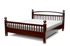 3d illustration of a modern wooden bed. 3d illustration of a modern elegant wooden bed Royalty Free Stock Photo