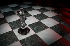 One chess figure on the playing field. Transparent crystal-glass king Royalty Free Stock Images