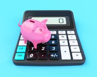3D Piggy bank and calculator. 3D Illustration. Piggy bank and calculator. Business and finance concept Royalty Free Stock Images
