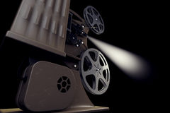 3D illustration of Retro film projector with light beam. 3D illustration of Retro film projector isolated on black back side view Stock Photo