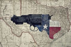 Texas gun on a railmap. 3d illustration of a rusty gun over the Texas rail map Stock Photo