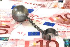 Rusty iron ball and chain connected to open cuff lying on euros. 3d illustration: rusty iron ball and chain connected to open cuff lying on euros banknotes Royalty Free Stock Photos