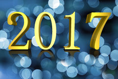 3D illustration Shining Golden text New Year 2017 blurred background Royalty Free Stock Photo