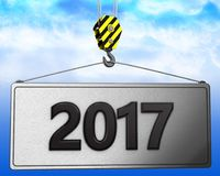 3d crane hook with 2017 sign. 3d illustration of 2017 sign with crane hook over sky background Stock Photos