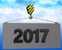 3d crane hook with 2017 sign. 3d illustration of 2017 sign with crane hook over sky background Stock Image