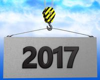 3d crane hook with 2017 sign. 3d illustration of 2017 sign with crane hook over sky background Royalty Free Stock Photo