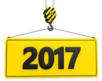 3d crane hook with 2017 sign. 3d illustration of 2017 sign with crane hook over white background Royalty Free Stock Photo