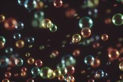 Soap Bubbles Dark Background. 3D illustration. Soap bubbles flying randomly stock illustration