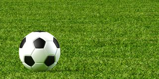 Soccer ball and lawn stock photo