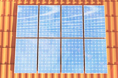 3D illustration solar panels on a red roff, power generation technology. Alternative energy. Solar battery panel modules Royalty Free Stock Image