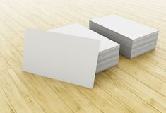3d Stack of blank business cards on wooden table. 3d illustration. Stack of blank business cards on wooden table. Mock up for your design stock illustration