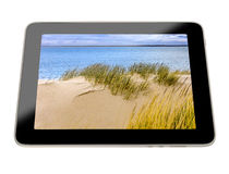 3D Illustration - Tablet with beach scene on display Stock Images