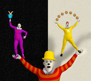 3D illustration of three colorful acrobat clowns. One yellow, one purple, one red. One of them is juggling Stock Photo