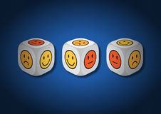 A 3D illustration of three dice with emotion symbols Stock Photo